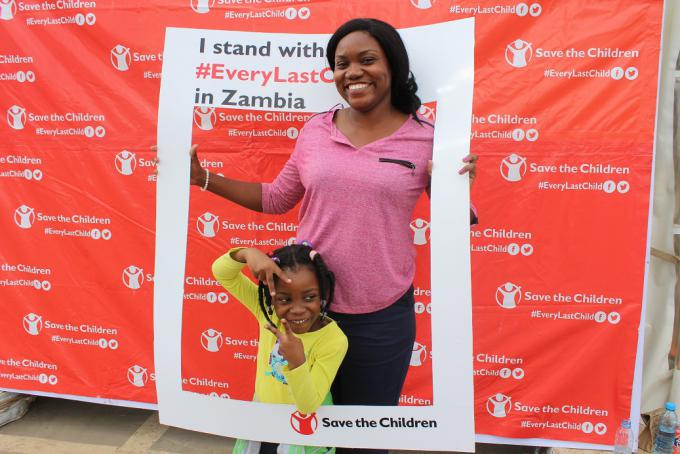 Pezo poses for a photo at the selfie corner with her daughter