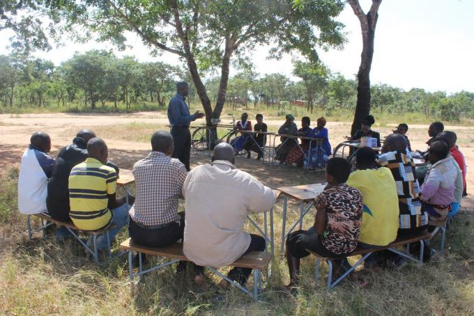 Kalongo community attending a focus group discussion with officials from Save the Children.